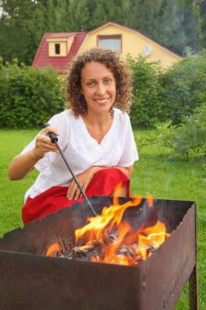 brazier: young woman near brazier on picnic