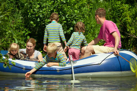 Children and adults float on an inflatable boat Stock Photo - 9113518