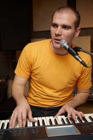 keyboarder playing near microphone Stock Photo - 9113320