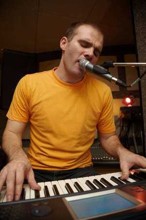 keyboarder is playing and singing photo