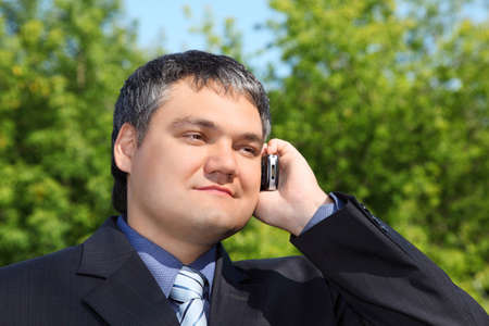 healthy llifestyle:  businessman speaking by phone outdoor in summer