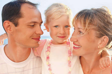 Happy family with little near to sea photo