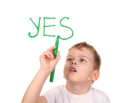 boy drawing word YES by felt-tip pen, collage Stock Photo - 9264897