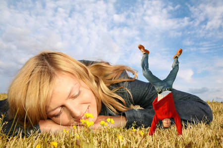 pygmy: young woman lies on the grass and miniature boy on hands collage