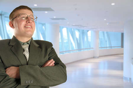 man in glasses  in business centre, collage    photo