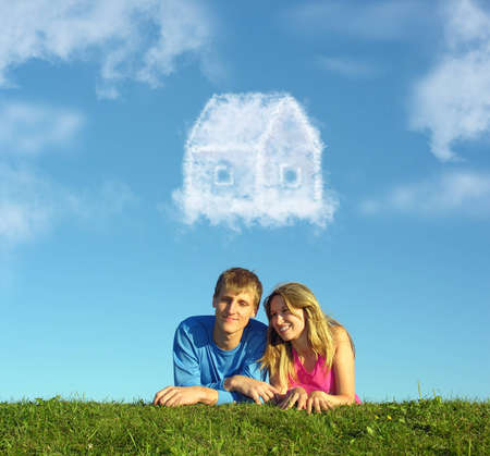 maisonette: smiling couple on grass and dream cloud house collage Stock Photo