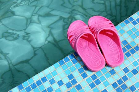 beachwear: Beach slippers on pool side  Stock Photo