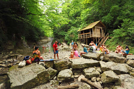 SOCHI, RUSSIA - JULY 15 People near a waterfall in Sochi, Russia. This year the resorts of Big Sochi expect to have about 4.4 million vacationers, or about 400 thousand more than in 2008. Sochi, Russia, July 15, 2009