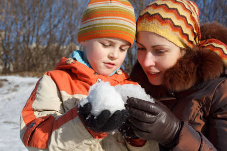 Mum with the son play with snow outdoor photo