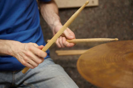 11396240: boom sticks in hands of drummer Stock Photo