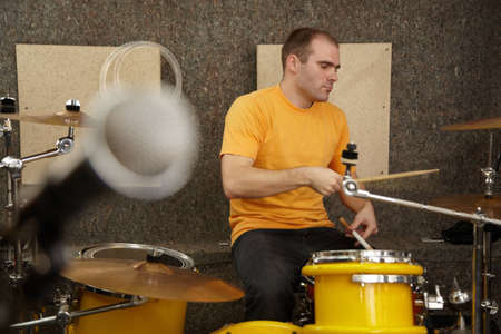drummer near drumkit. microphone in out of focus Stock Photo - 11586775