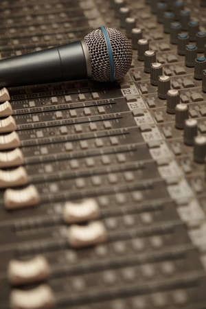 pult: microphone on old dirty sound mixer pult. microphone in focus Stock Photo