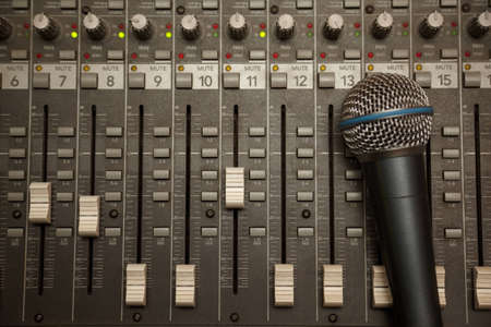 microphone in old dirty sound mixer pult Stock Photo - 11396816
