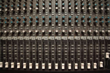 regulators: old dirty sound mixer pult. crossfaders and regulators