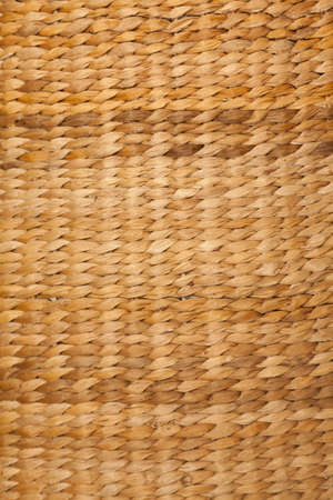 straw mat: Texture high resolution of brown color of woven basket. Close up. Vertical format. Stock Photo
