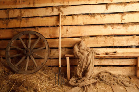 pitchfork: Interior of village building. Wheel, pitchfork, bench, cloth, bast shoe.