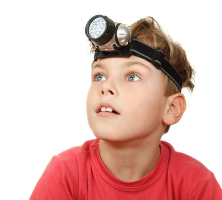 Portrait of boy with flashlight on his head on white background. Looks aside. Stock Photo - 11574745