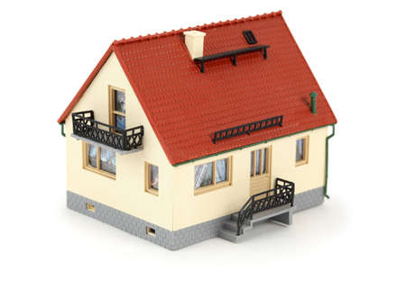 Model house with tiled roof. Isolated on white background. photo