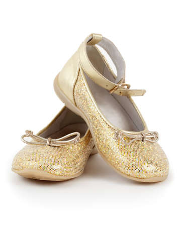 cinderella shoes: Pair of shiny golden shoes for girls on white background.