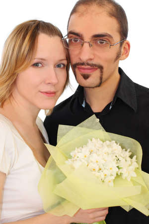 portrait of man in glasses and beauty blond girl with flowers bouquet, looking at camera, isolated on white photo