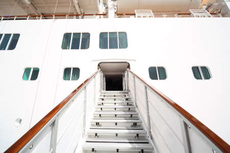 entrance with rails and stairs in large white passenger liner summer day photo