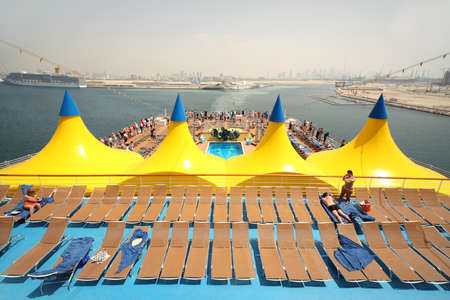 general view on ship deck with blue floor, swimming pool and deck chairs Stock Photo - 11689521