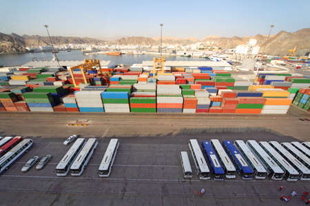 procurement: shipping port with buses and containers for cargo transportation view from above Stock Photo