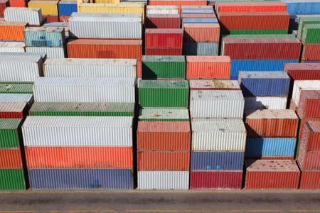 procurement: multicolored containers for cargo transportation on ship