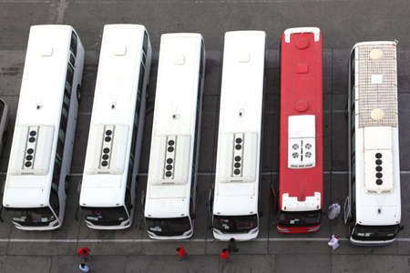 regular people: regular buses on station and drivers in uniform view from above