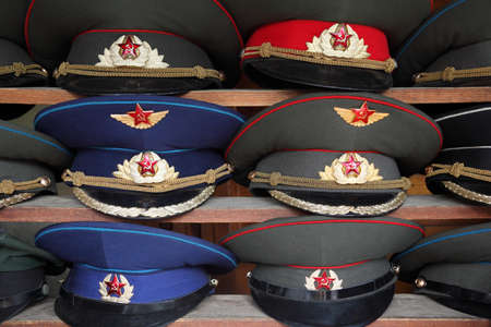 rank: ussr polisman uniform hat with visor on wooden shelf