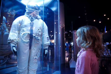 astronautics: MOSCOW - NOVEMBER 8: Little girl acquaints with history in an astronautics museum , November 8, 2009 in Moscow, Russia.