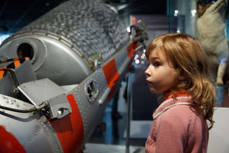 MOSCOW, RUSSIA - NOVEMBER 8: In an astronautics museum acquaint children with historyNovember 8, 2009 in Moscow, Russia.