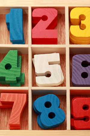 math game for junior age with colored wooden signs of numbers vertical photo