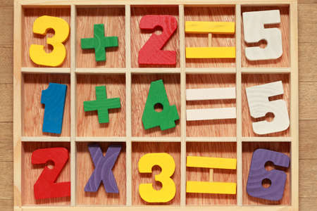 arithmetic: game for junior age with colored wooden numbers arithmetic operations