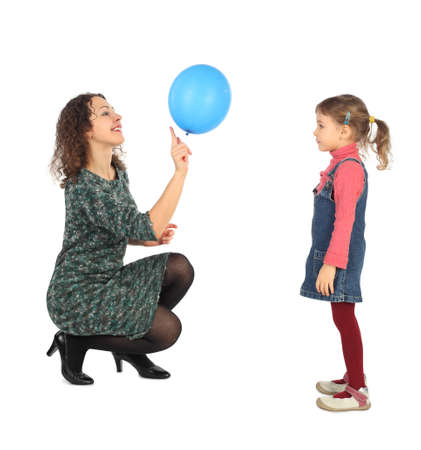 see side: little girl and her mother playing with blue balloon side view isolated on white
