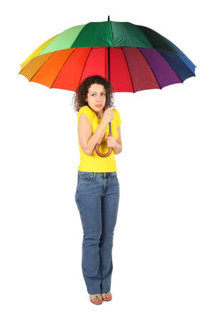 young frozen beauty woman in yellow shirt with multicolored umbrella standing isolated on white photo