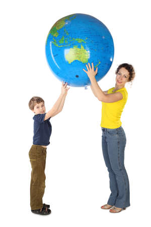 mother earth: mother and son holding big inflatable globe and looking at camera, side view, isolated