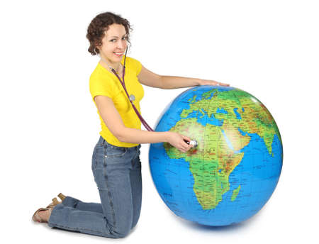 young beauty woman with stethoscope and big inflatable globe, smiling and looking at camera, isolated on white Stock Photo - 12130402