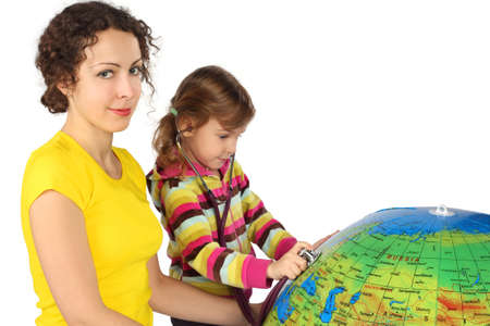 mother and little girl with stethoscope and big inflatable globe, focus on mother Stock Photo - 12130659