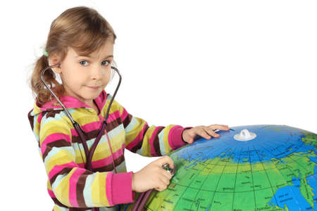 little girl with stethoscope and big inflatable globe, looking at camera, horizontal Stock Photo - 12130566