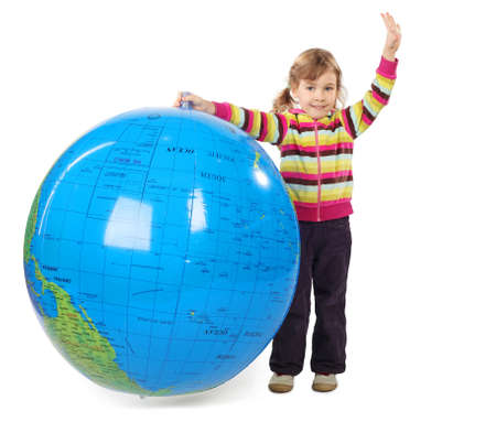 little girl standing and holding big inflatable globe, putting other hand up, isolated on white Stock Photo - 12130364