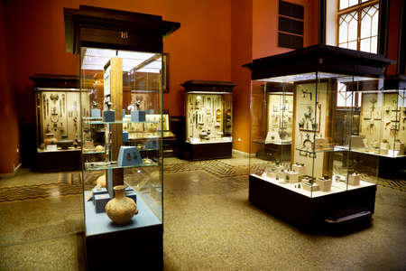ancient relics: museum exhibits of ancient relics in glass cases Editorial