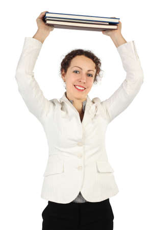 young brunette woman in business dress holding stack of books over her head and smiling, isolated on white Stock Photo - 12130260