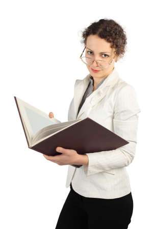 dignified: young serious woman in glasses holding big book, looking at camera, isolated on white