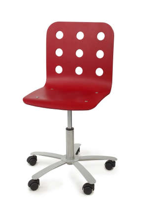 metal base: red modern armchair with circle holes on back, metal base and black wheels, isolated on white