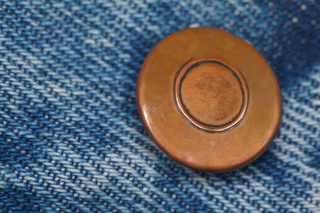 wear a piece of blue denim structure of the yellow button, label was made by me. macro photo