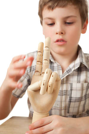 beautiful boys: boy is played by wooden hand of manikin isolated on white background
