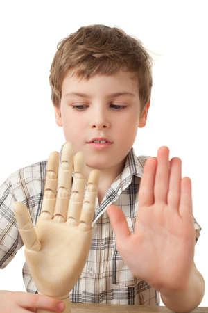 1 boy only: boy is played by wooden hand of manikin isolated on white background, Two palms