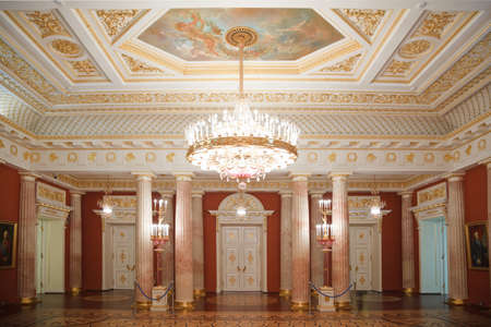 ceiling: golden with red room of State historical and architectural museum reserve Tsaritsyno, Russia. It was build in 1776.