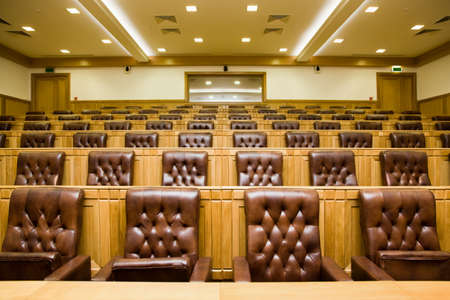 Conference halls with magnificent leather armchairs and wooden tables with microphones Stock Photo - 11728428